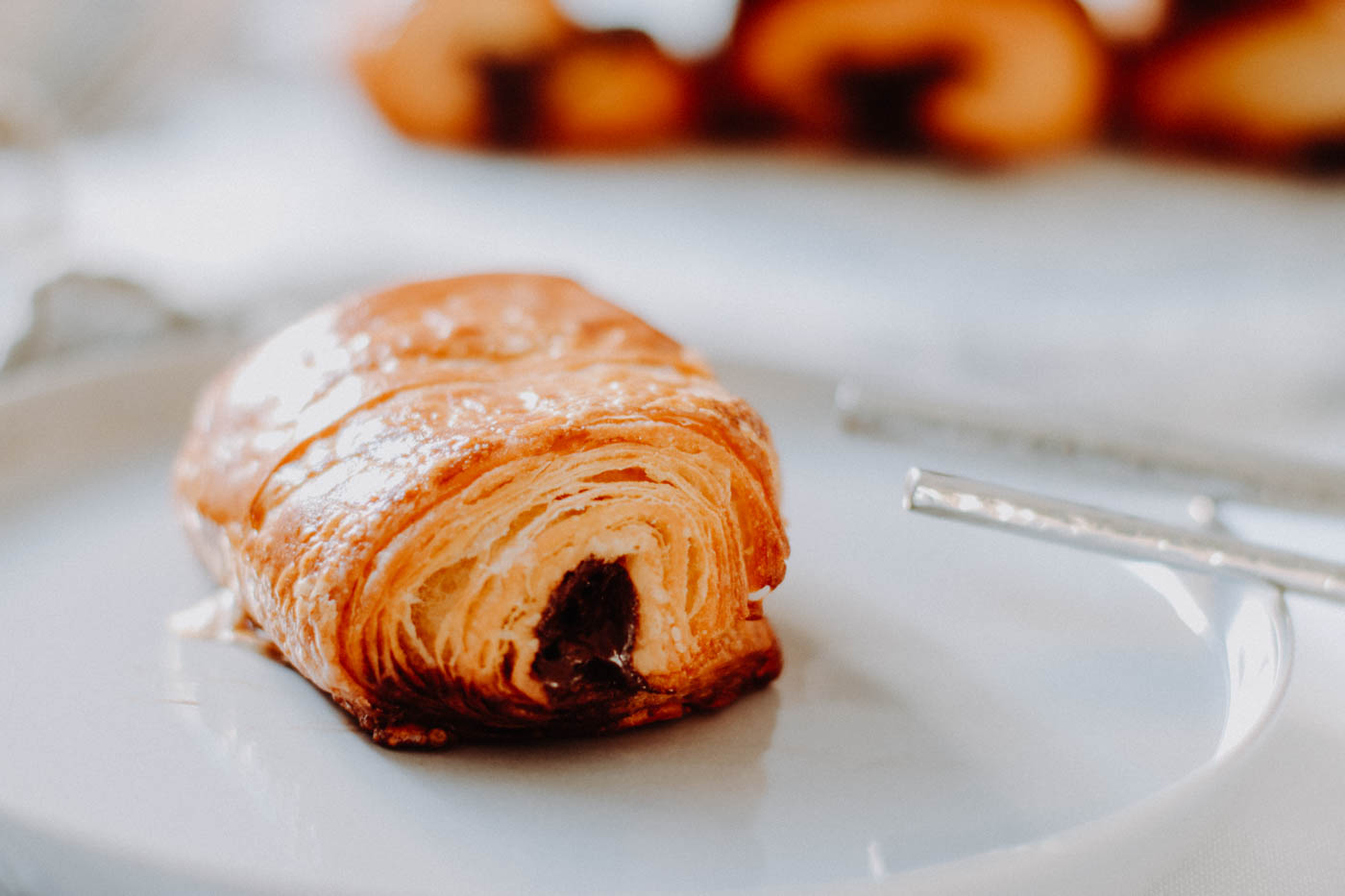 Pain au chocolat Layers after layers of deliciousness: Buttery dough wrapped around dark chocolate.